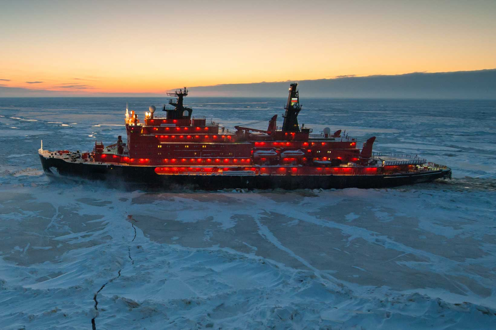 Icebreaking vessel in Arctic with background of sunset