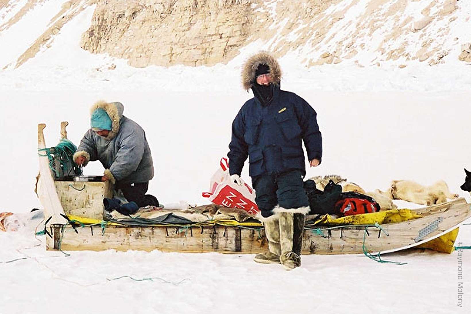Two men on sledge